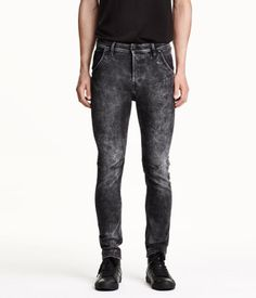 5-pocket low-rise pants with a washed denim look with distressed details and ultra-slim, shaped legs. Concealed drawstring at waist, button fly, coin pocket with button, and extra pocket at back with concealed, taped zip.