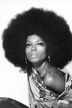 This is a photo of famous soul singer Dina Ross sporting the Afro hairstyle. During the 60s. the Afro was seen as a symbol of feminism and black power. You see more of the Afro hairstyle in the 70s as well.