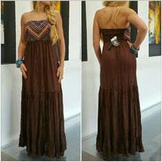 Maxi dress NWT Brand new with tags  Fabulous strapless maxi dress in chocolate brown and features an array of colors in chevron print on top. Absolutely perfect for this season!!  100% rayon  Comes with clear straps. Dresses