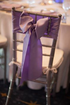 A simple purple bow on a chiavari chair makes for a stunning reception seat