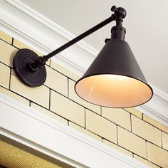 Library lamps provide over-the-sink task lighting and another sophisticated bronze accent in the room | thisoldhouse.com | from Kitchen Practicality Meets Period Style