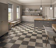 Vusta Cotswold Stone and Penrhyn Slate flooring tiles laid in a checkerboard design. Get free samples at www.vusta.co.uk #greyflooring #floortiles #vinylflooring #kitchenflooring