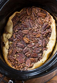 Here's an easy way to make a delicious pecan pie - in your crock pot!  Just use refrigerated pie crust, eggs, sugar, dark corn syrup, butter, vanilla, pecans and then top with vanilla ice cream!