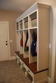 mud room ideas - Wood bench to match beams and crown molding.