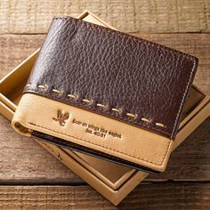 """This strongly constructed, two-tone genuine leather, men's Bible verse wallet features contrast stitching and is debossed with the powerful words of scripture from Isaiah 40:31 """"Soar on wings like eag"""