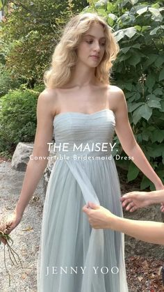 Meet Maisey, This flowy, multiway tulle bridesmaids dress is made of only the highest quality of soft chiffon shown here in a dusty shade of light green called Sage. The flattering infinity Turner dress features 4 built in convertible panels created to give you the ability to tie it however you'd like for endless different looks. It also comes with a detachable sash that you can tie around the waist, or for additional customization.