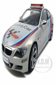 Brand new 1:18 scale diecast car model of BMW M6 Moto GP 2007 Safety Car die cast car by Kyosho. Has steerable wheels. Brand new box. Rubber tires. Made of diecast with some plastic parts. Detailed interior, exterior, engine compartment. Dimensions approximately L-10.5, W-4.5, H-3.5 inches. BMW M6 Moto GP 2007 Safety Car Diecast Car Model 1/18 Die Cast Car by Kyosha Bmw M6, Bmw Models, Rubber Tires, Diecast Model Cars, Motogp, Buy Bmw, Safety, Wheels, Vehicles
