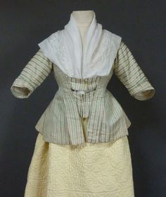 Caraco, Netherland, 1770's. Silk woven with pale green stripes with a minute pattern alternating with ivory stripe woven with brown stylised flower pattern.