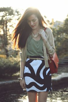 Sarah Vickers of Classy Girls Wear Pearls wears a BLUE PEPPER top, vintage skirt, and PRINGLE OF SCOTLAND cardigan.