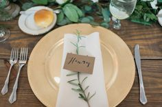 Rustic Wedding Day Place Setting with Gold Plate Charger on Wooden Feasting Table with Greenery | Tampa Wedding Planner Inspire Weddings and Events