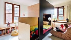 A simple structure in the centre of this room helps to stop squabbles between the children sharing the space.