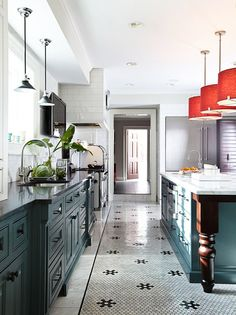 I've really been loving slate blue cabinets, and they look great in this vintage-inspired kitchen.  The pops of red from the pendants add so much pizzazz.