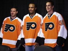 Flyers new acquisitions from left,  Mark Streit, Ray Emery, and Vincent Lecavalier pose for photographs during a news conference, Tuesday, July 9, 2013, in Philadelphia. (Matt Rourke/AP)