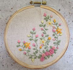 bullion-stitch roses, rosebuds, other flowers, vine with leaves