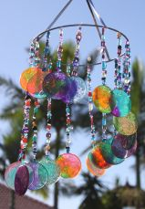 DIY sun catcher Wind Chime. Recycled plastic and beading.