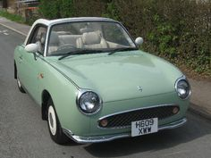 ah, the nissan figaro. you wee beauty. goes well with a matching vw camper....