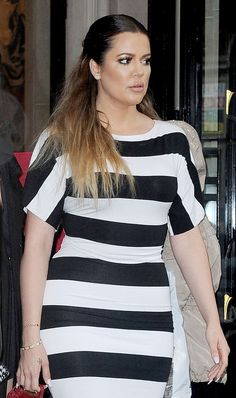 Khloe Kardashian out in Paris. Her hair should have been better