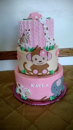 pink monkey jungle baby shower cake  - *  pink and tan monkey jungle baby shower cake.   loves the little animals! my favorite part though was the little brown fondant branches between each tier.