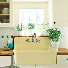 Farm house sink with butcher block countertops? Yes, please.