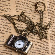 Kiki's Vintage Style Camera Watch Pendant Necklace ($20) ❤ liked on Polyvore featuring jewelry, necklaces, vintage style jewelry, vintage style necklace, antique brass necklace, pendant necklace and vintage looking jewelry