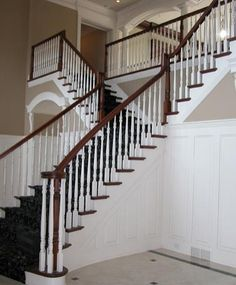 Carpeted and Stained Stair and Rail with Painted Balusters