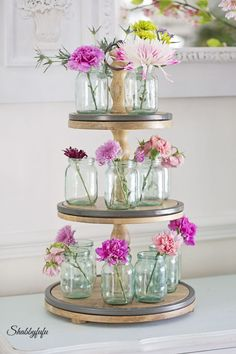 Multi-tired Stand filled with old mason jars and wild flowers is the perfect setting for a Mother's Day tea or brunch from Shabbyfufu.