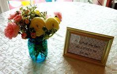 kitchen themed bridal shower - table decor; fresh flowers and framed quotes from the groom about the bride :)