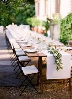 Tuscan villa outdoor wedding decor: http://www.stylemepretty.com/2017/02/23/tuscan-villa-wedding-featuring-a-dreamy-family-style-reception/ Photography: Vasia - http://www.vasia-weddings.com/