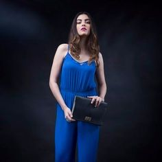 Transform into a modish, fun belle after a hard day at work wearing a royal blue jumpsuit, black block heels, hair well-swept and don't forget to hold a black #clutch in your palm to complete the party look. The #clutch is available at Exclusive Baggit Stores and www.baggit.com. #GetTheLook #clutches #womensfashion #Baggit #afterhours #partylook #womensbags