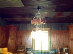 This is a mason jar light fixture I built for above my kitchen island