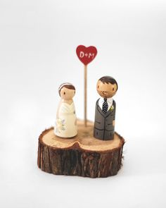 Custom Rustic Handcrafted Hand Painted Wedding Cake Topper/Decoration Piece / Tree Slice Wedding Cake Topper. $60.00, via Etsy.
