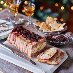 The overnight pressing helps make this zesty terrine sliceable. We stamped out festive shapes from our toasts to add a fun factor Pate Recipes, Terrine Recipes, Cooking Recipes, Xmas Food, Christmas Cooking, French Terrine Recipe, Charcuterie, Chicken Terrine, Liver Pate Recipe