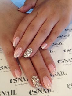 one of my favorite looks.. neutral with a super glittery accent nail!  | Check out http://www.nailsinspiration.com for more inspiration!