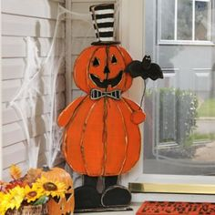 A festive and friendly face for your porch. Wooden Jack-O-Lantern Man Statue | Kirklands #kirklandshalloween #kirklands