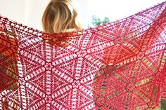 Scarlet Berry is a V-shaped shawl made of crochet motifs, using a join-as-you-go method which eliminates having to sew all the motifs together.