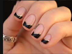Love these –– modified, angular black & gold French tips.
