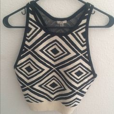 Urban outfitters top Brand new never worn urban outfitters top. Sweater vest style top. White and black print. Tag attached. Great for layering. NO TRADE, PRICE IS FIRM. Urban Outfitters Tops Tank Tops
