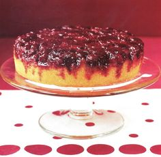 The topping for this cake is simple: cranberries are placed over sugar and spices at the bottom of the pan. As the cake bakes, the sugar caramelizes, forming a syrup. When you invert the pan, the syrup soaks into the cake, creating a festive dessert.