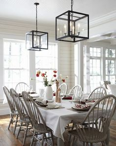 such a lovely dining area. Great for a gathering! Love the double light fixtures.
