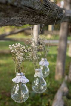 Dress up you light bulb vases with some delicate lace and dried baby's breath!