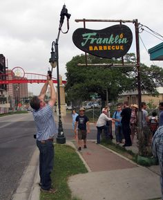 It wasn't easy, but Dallas Morning News Staff Photographer Tom Fox figured out how to shoot the line and the sign at Franklin Barbecue. (Chris Wilkins/Texas BBQ Posse)