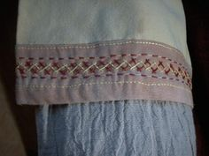 Double herringbone stitch decorating tunic cuffs. By Kadlin