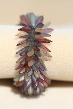 http://randomcreative.hubpages.com/hub/Czech-Glass-Dagger-Beads-Patterns-and-Stunning-Jewelry-Inspiration