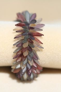 http://randomcreative.hubpages.com/hub/Czech-Glass-Dagger-Beads-Patterns-and-Stunning-Jewelry-Inspiration