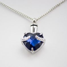 Cremation necklace for ashes featuring a luminous blue heart gemstone in a stainless steel setting. Cremation jewelry is a discreet solution for a memorial. Body Jewelry Shop, Jewelry For Her, Jewelry Accessories, Jewelry Design, Women Jewelry, Cremation Jewelry, Pet Cremation, Memorial Jewelry, Cool Necklaces