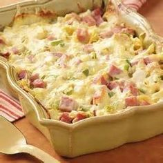 """Ham and Swiss Casserole Recipe- Recipes """"When I prepare this noodle casserole for church gatherings, it's always a hit,"""" writes Doris Barb from El Dorado, Kansas. """"It can easily be doubled or tripled for a crowd. Ham Casserole, Casserole Dishes, Casserole Recipes, Ham And Noodle Casserole, Cauliflower Casserole, Broccoli Casserole, Pork Recipes, Great Recipes, Cooking Recipes"""