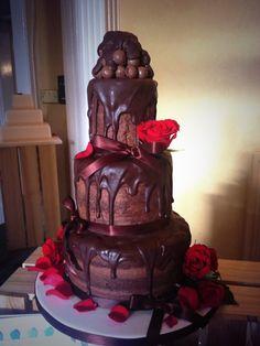 Indulgent dripping chocolate wedding cake.