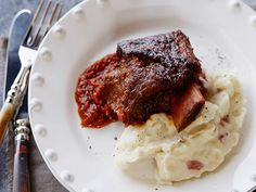 Braised Short Ribs from FoodNetwork.com. These are by far one of my favorites!!! It is unbelievable, and when we make it for friends they LOVE it!!!