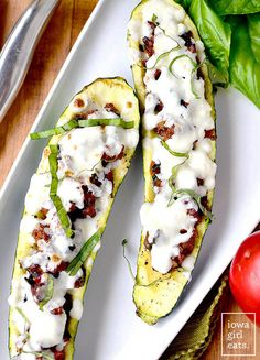 Italian Tomato-Basil Stuffed Zucchini is a light and low-carb, gluten-free summer dinner recipe. Simple and satisfying.   iowagirleats.com