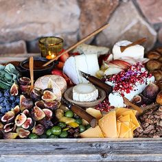 Part of the autumn harvest cheeseboard from the wedding at High Star Ranch Utah. Humboldt fog Red Hawk chèvre with pomegranate & nigella seeds pumpkin butter whiskey pecans Turkish fig grapes pluot apple red pear olives in olive oil & lemon. by ramblinrosecafe